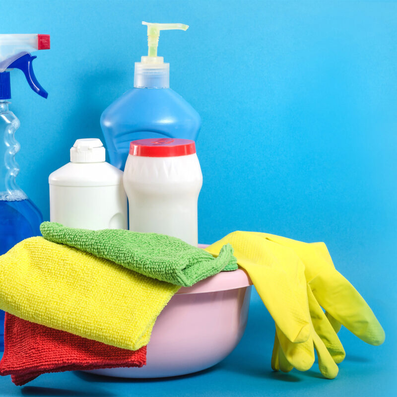 Background banner with home cleaning products with colorful napk