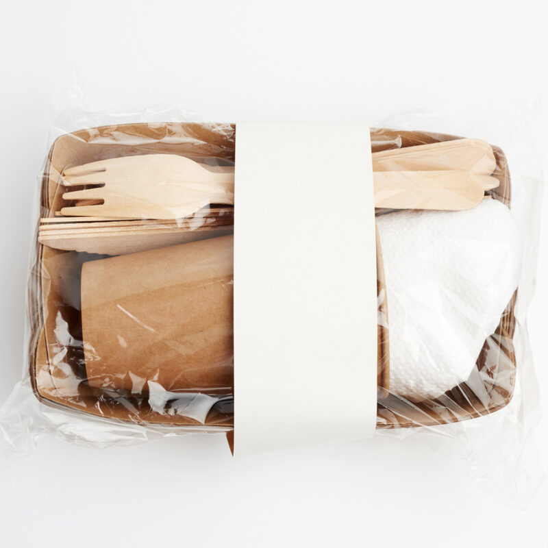 paper plates and cups from brown craft paper and wooden forks an